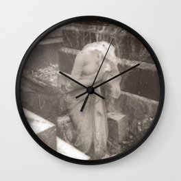 beheaded devotion Wall Clock