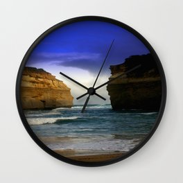 Between the sea Giants Wall Clock