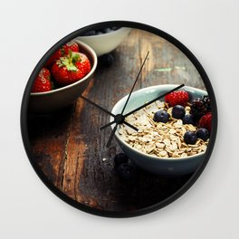 Bowls with cereals and fresh berries on wooden table Wall Clock