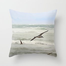Seagulls flying over rough sea Throw Pillow
