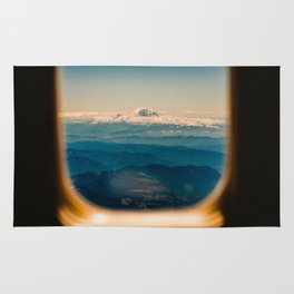 Mount Rainier seen through an airplane window Rug