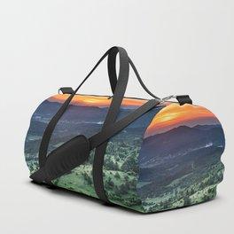 Beautiful sunset behind green fields Duffle Bag