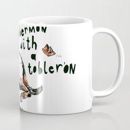 A Dobermon With a Toblerone Coffee Mug