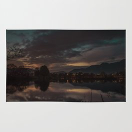 Sunset by the lake Rug