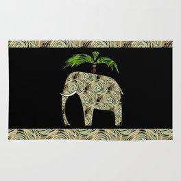 Elephant under a palm tree . Rug