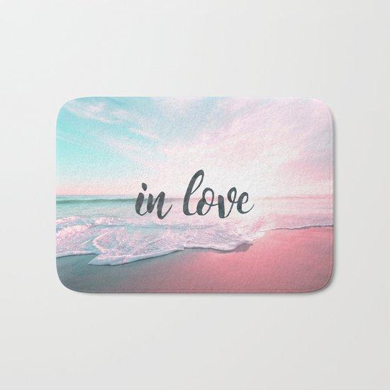 In Love on the beach Bath Mat