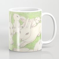 bunnies Mugs featuring Bunnies by Adi Yochalis