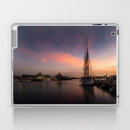 Sailboat moored in Long Beach at sunset Laptop & iPad Skin