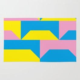 Trapezi e altre forme. Rosa, azzurro, giallo. Sembrano piccoli ponti per bambini, fatti in legno. Rug