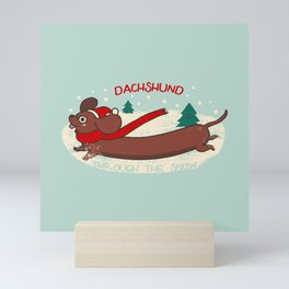Dachshund through the snow Mini Art Print