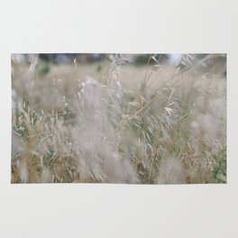 Tall wild grass growing in a meadow Rug