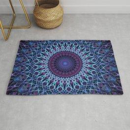 Mandala in dark and light blue tones Rug