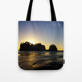 sun setting behind james island, washington, usa  Tote Bag