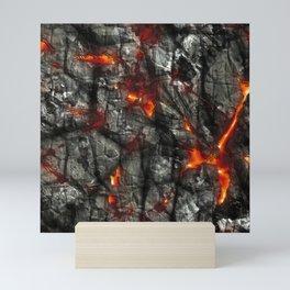 Fiery lava glowing through dark melting stone Mini Art Print