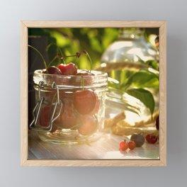 Fresh cherrie in glass Framed Mini Art Print