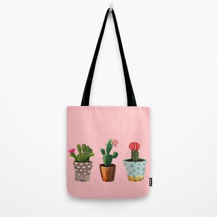 Three Cacti With Flowers On Pink Background Tote Bag