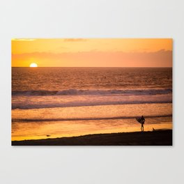 Surfer watching sunset in Southern California Canvas Print