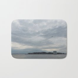 Clouds Over Governor's Island Bath Mat
