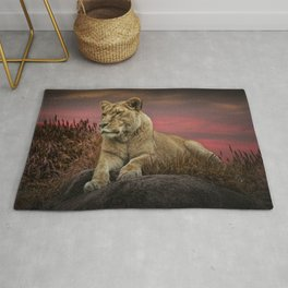 African Female Lion in the Grass at Sunset Rug