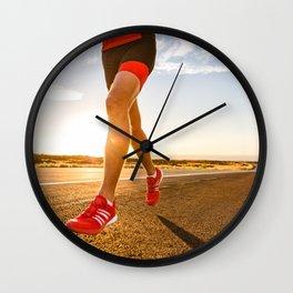 Triathlon running athlete training on road in running shoes Wall Clock