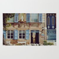 jewish Area & Throw Rugs featuring Blue Shutters in the Sun by Brown Eyed Lady