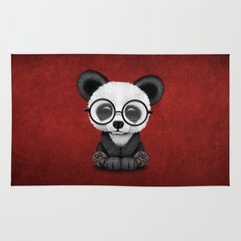 Cute Panda Bear Cub with Eye Glasses on Red Rug