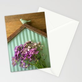 Birdhouse flatlay with wildflowers Stationery Cards