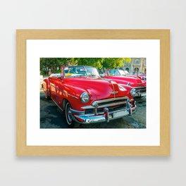 Beautiful red vintage taxis in Havana, Cuba. Framed Art Print