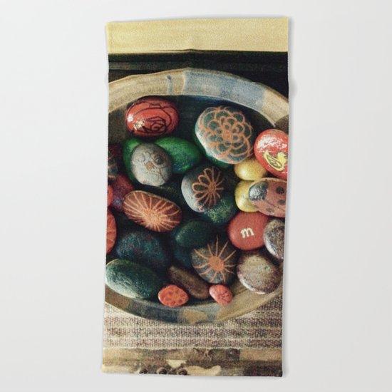 Rock art in ceramic bowl Beach Towel
