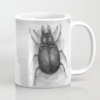 beetle Mugs featuring Beetle by Salih Gonenli