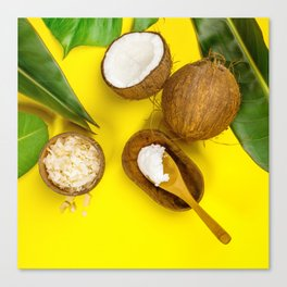 Coconut oil, tropical leaves and fresh coconuts, top view Canvas Print