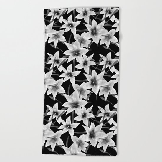 White lilies on a black background . Beach Towel