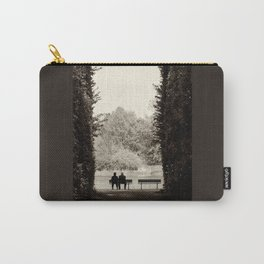 Two old people sitting on bench between hedge Carry-All Pouch