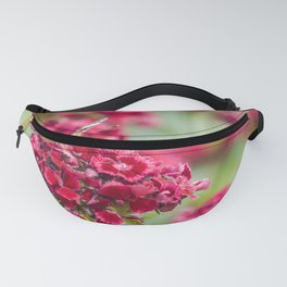 Red flowers and a beautiful butterfly Vanessa atalanta Fanny Pack