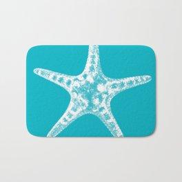 Sea star in blue Bath Mat