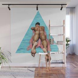 Guy floats on an air mattress Wall Mural