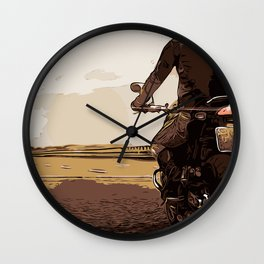 The motorcyclist, a biker on the road. Wall Clock