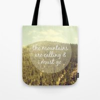 the mountains are calling Tote Bags featuring The Mountains are Calling by Jillian Audrey