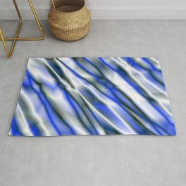A bright cluster of blue bodies on a light background. Rug