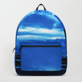 Arm from Above Plays with the Sunset Backpack