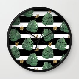 Tropical leaves pattern on stripes background Wall Clock