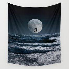Kitesurfer in the moon in blue night sky horizon Wall Tapestry