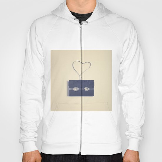 Retro black music cassette and heart shaped tape on beige background Hoody