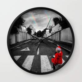 little girl with red riding hood pointing rainbow from the street in black and white selective color Wall Clock