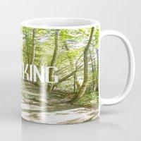 hiking Mugs featuring Go Hiking by Jennifer Kimberly