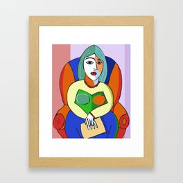 Woman With A Kindle Framed Art Print