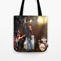 arctic monkeys Tote Bags featuring Arctic Monkeys in Williamsburg, New York by The Electric Blue / Yen-Hsiang Liang (Gr