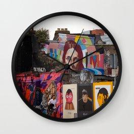 Street Art on a City Block Wall Clock