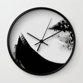 pois on mouth Wall Clock