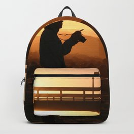 Photographer At Sunset Backpack